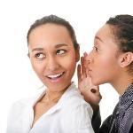 portrait of two dark-skinned women on white background
